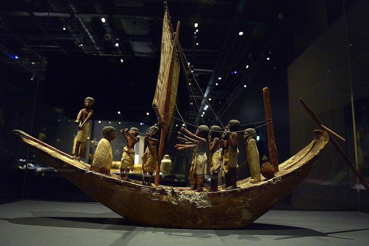 On show are artefacts such as this painted wooden model of a boat from Meir, Middle Egypt, from the 12th Dynasty or around 1900 BC.