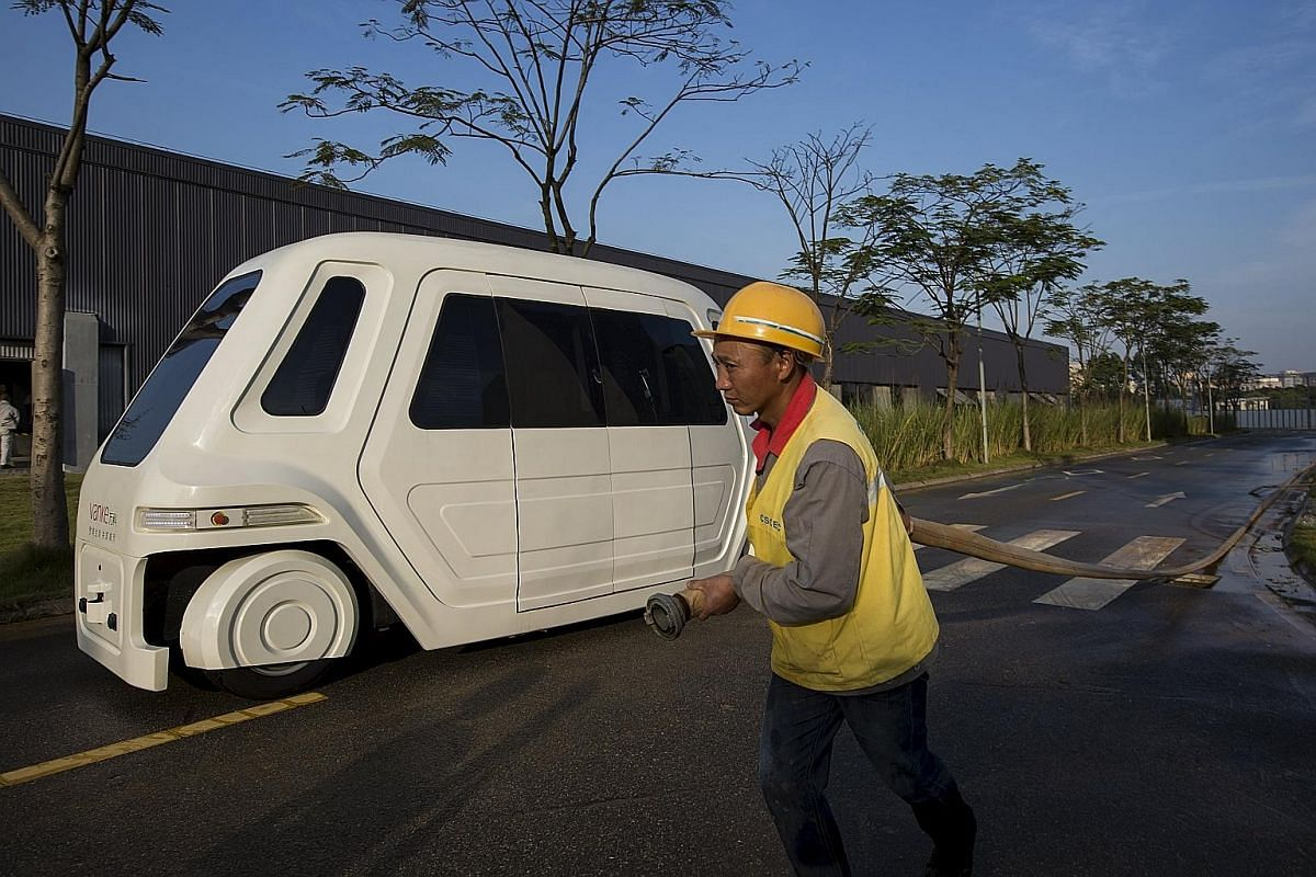 Joining the driverless car race: A driverless vehicle at Vanke's Building Research Centre in Dongguan in China's Guangdong province.