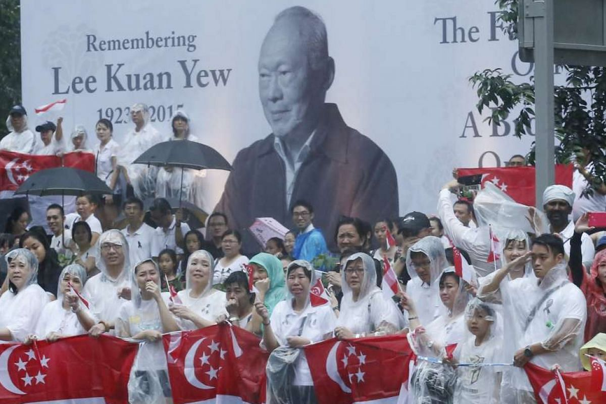 Mourners waiting in pouring rain outside the NTUC headquarters at 1 Marina Boulevard for Mr Lee Kuan Yew's cortege to pass on March 29.