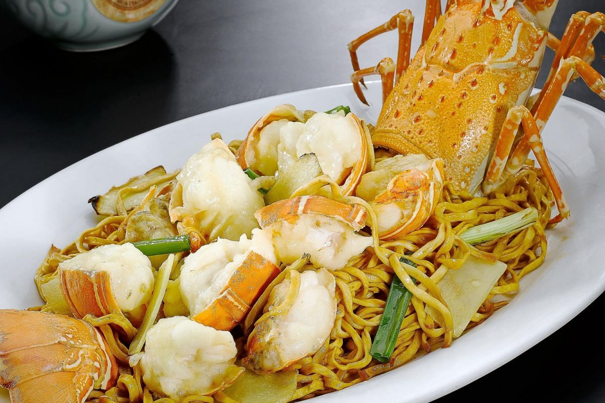 Lobster And Noodles With Ginger And Spring Onion.