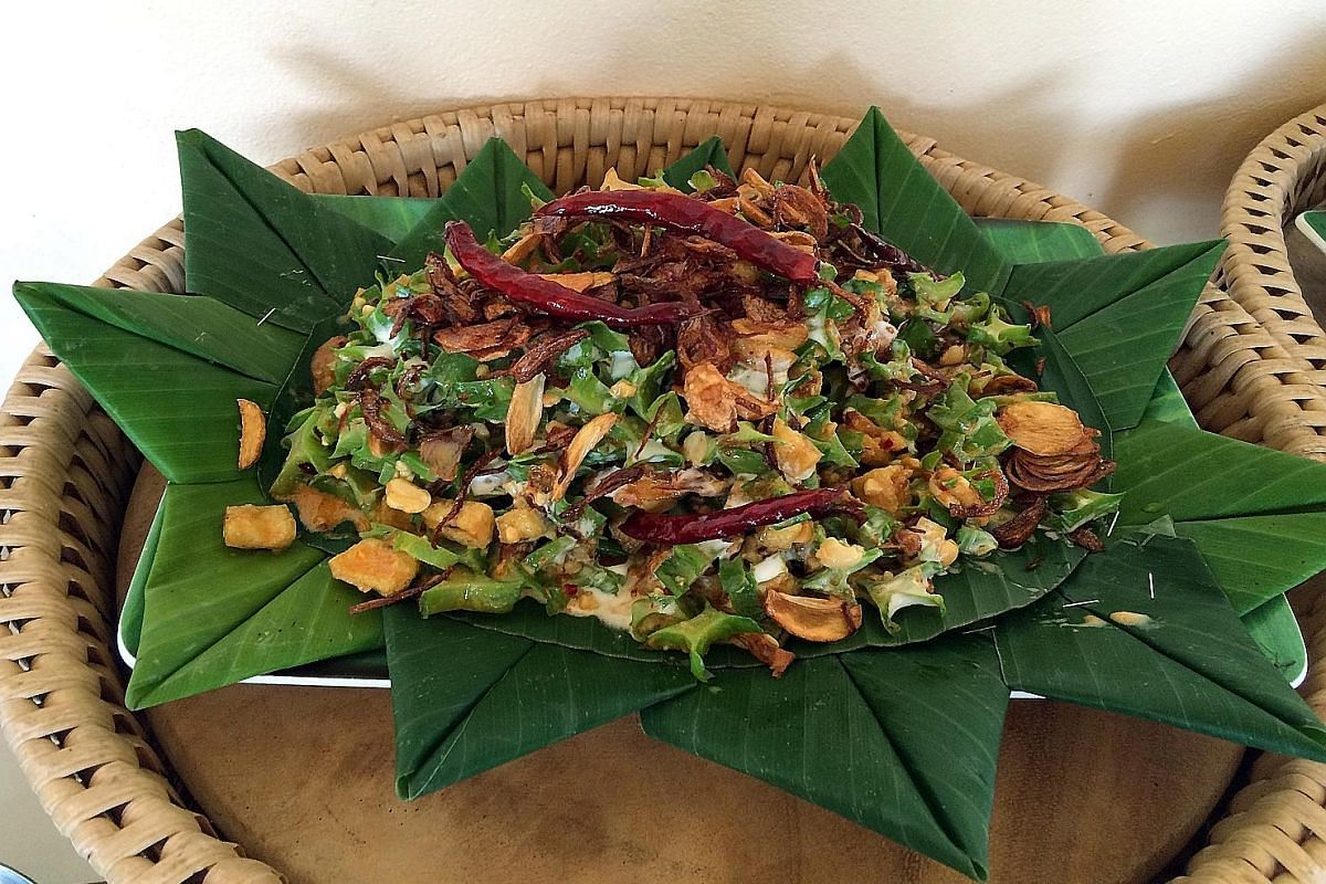 A morning meditation and yoga session (right) in Museflower Retreat & Spa's octagonal studio. The resort (left) is built around a small lake. Winged-bean salad (left) made with beans from the resort's farm. Resort chef Santot (above) with duck eggs h
