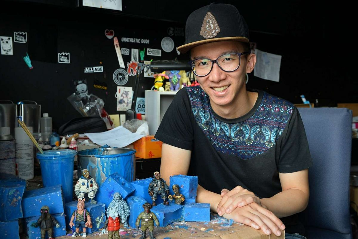Mr Daniel Yu (above) and Mr Jake Lee have turned their toy-making hobbies into careers. Singapore company Flabslab also produces toys, such as this figurine The Ghost Of Kurosaw, which was designed by Philippines based toy designer Juanito Maiquez.