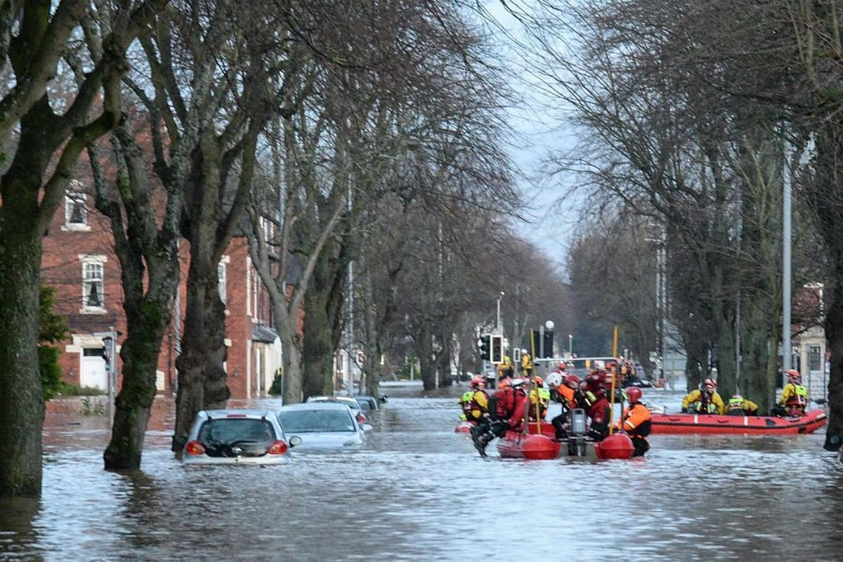 Picture made available by the British Ministry of Defence shows British soldiers assisting in evacuating residents in Carlisle, North West England, Britain, on Dec 6, 2015.