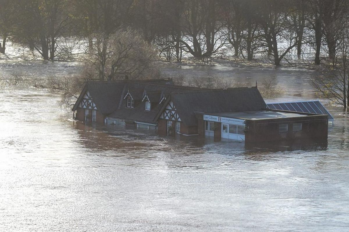 Picture made available by the British Ministry of Defence shows partially submerged buildings, North West England, Britain, on Dec 6, 2015.