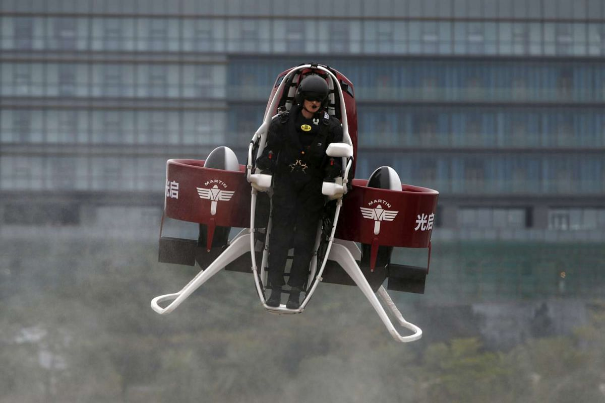 Mr Michael Read, the director of Flight Operations at New Zealand-based Martin Aircraft Company, flies a Martin Jetpack during a demonstration at a water park in Shenzhen, China, on Dec 6, 2015.