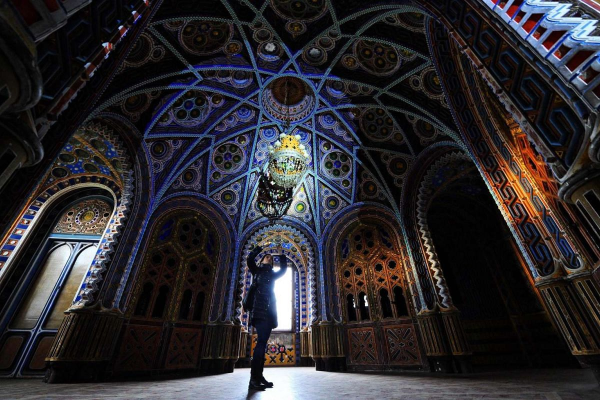 A visitor taking pictures inside the Castle of Sammezzano during a special opening to the public of the palazzo in Leccio, in the Province of Florence, Italy, on Dec 6, 2015.