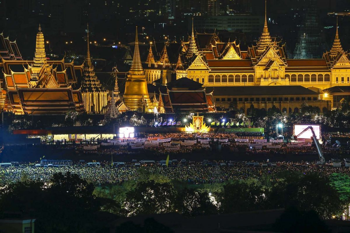 Thousands of people hold candles in front of the Grand Palace as they celebrate the 88th birthday of Thailand's King Bhumibol Adulyadej, in Bangkok, Thailand, on Dec 5, 2015.