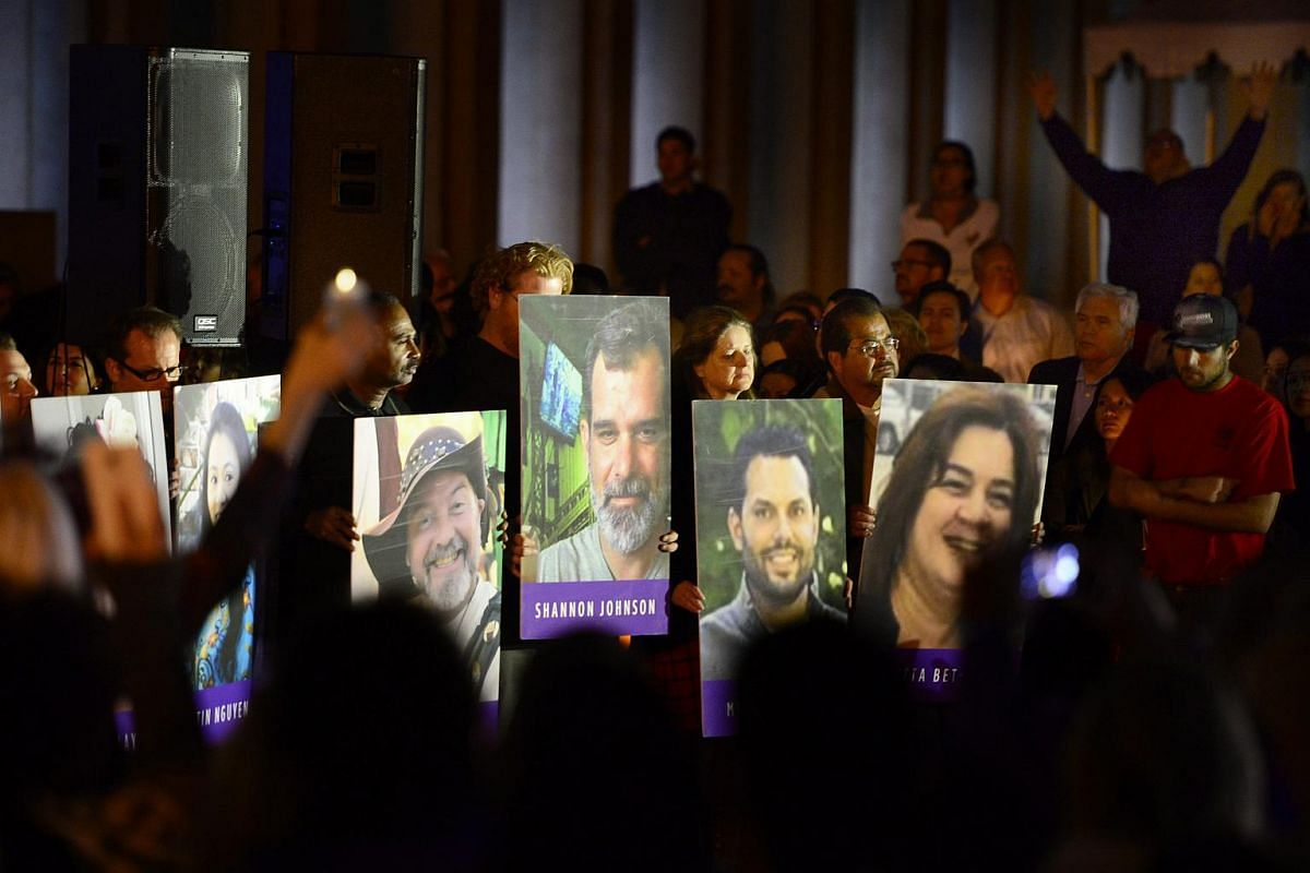 Photos of the victims of the mass shooting displayed during a candlelight vigil in downtown San Bernardino, California, USA, on Dec 7, 2015.
