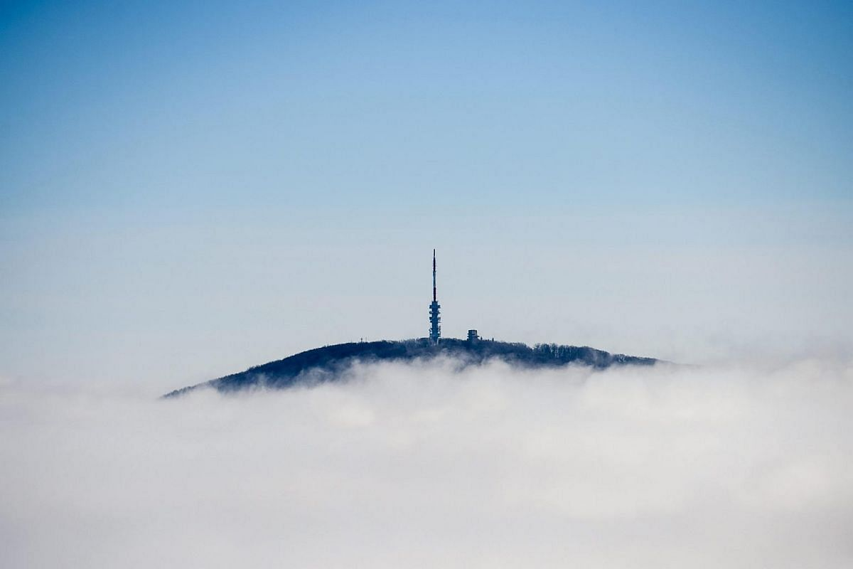 A television transmission tower sitting on the top of Kekes Mountain emerging from a sea of clouds in the Matara Mountains, 105km north-east of Budapest, Hungary, on Dec 7, 2015.