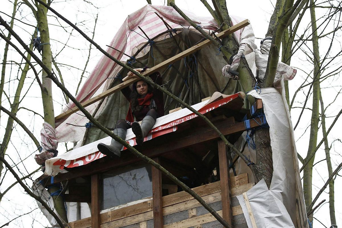 Anti-Heathrow expansion activist sitting in a tree house at the Grow Heathrow protest camp in the village of Sipson near Heathrow Airport, west London, Britain, on Dec 7, 2015.