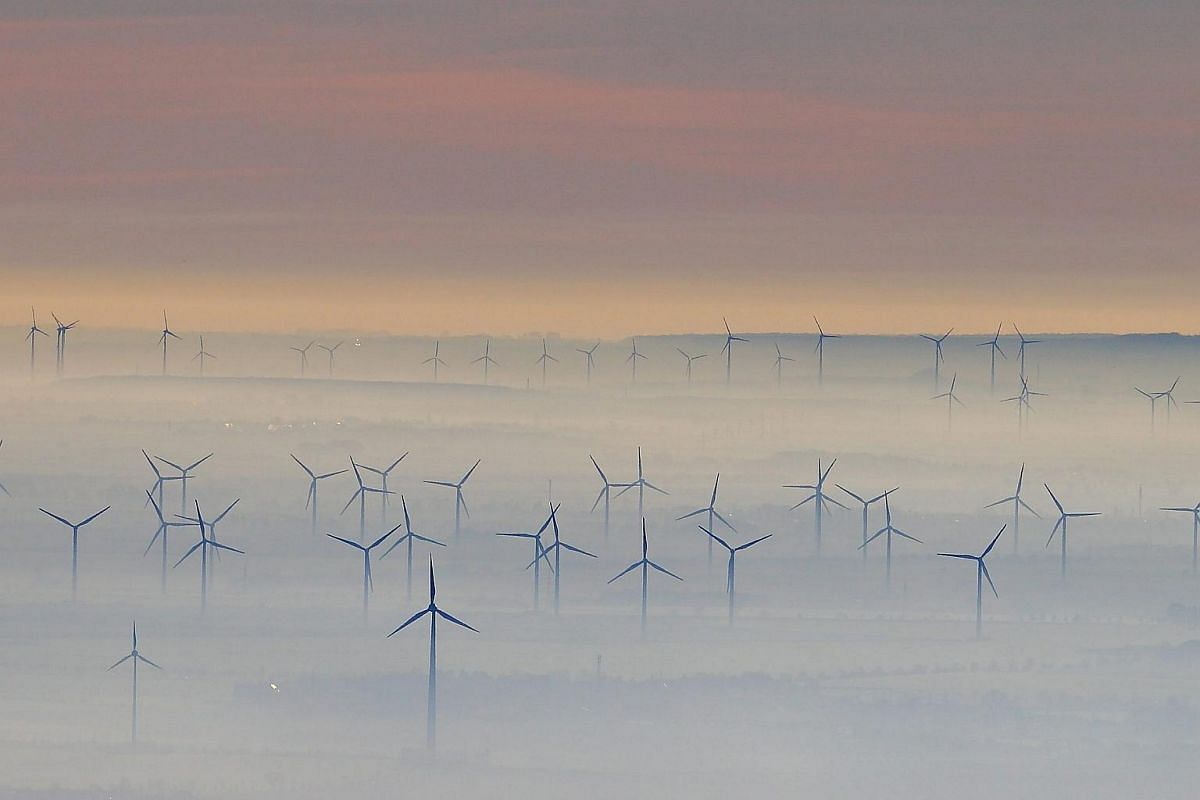 Wind turbines is surrounded by fog near the Petersberg mountain in Germany, on Dec 8, 2015.