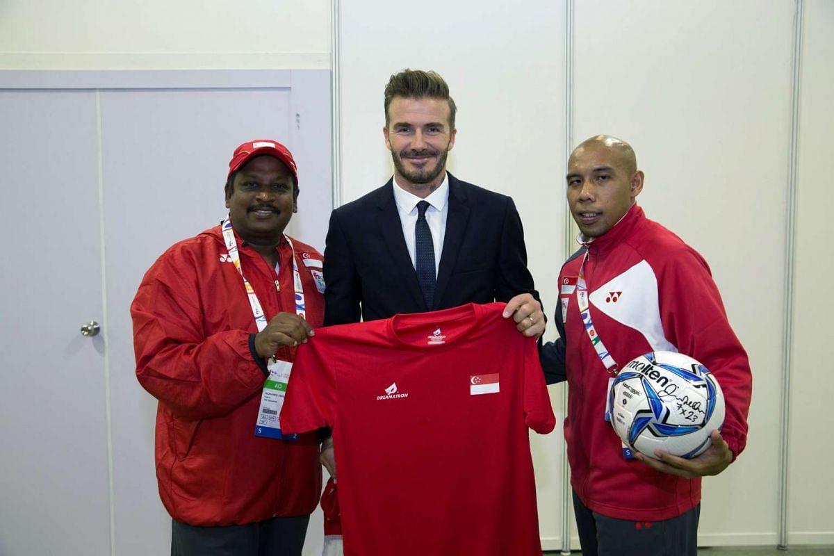 (From left) Coach Mohamed Zainudeen, football legend David Beckham and cerebral palsy footballer Khairul Anwar Kasmani.