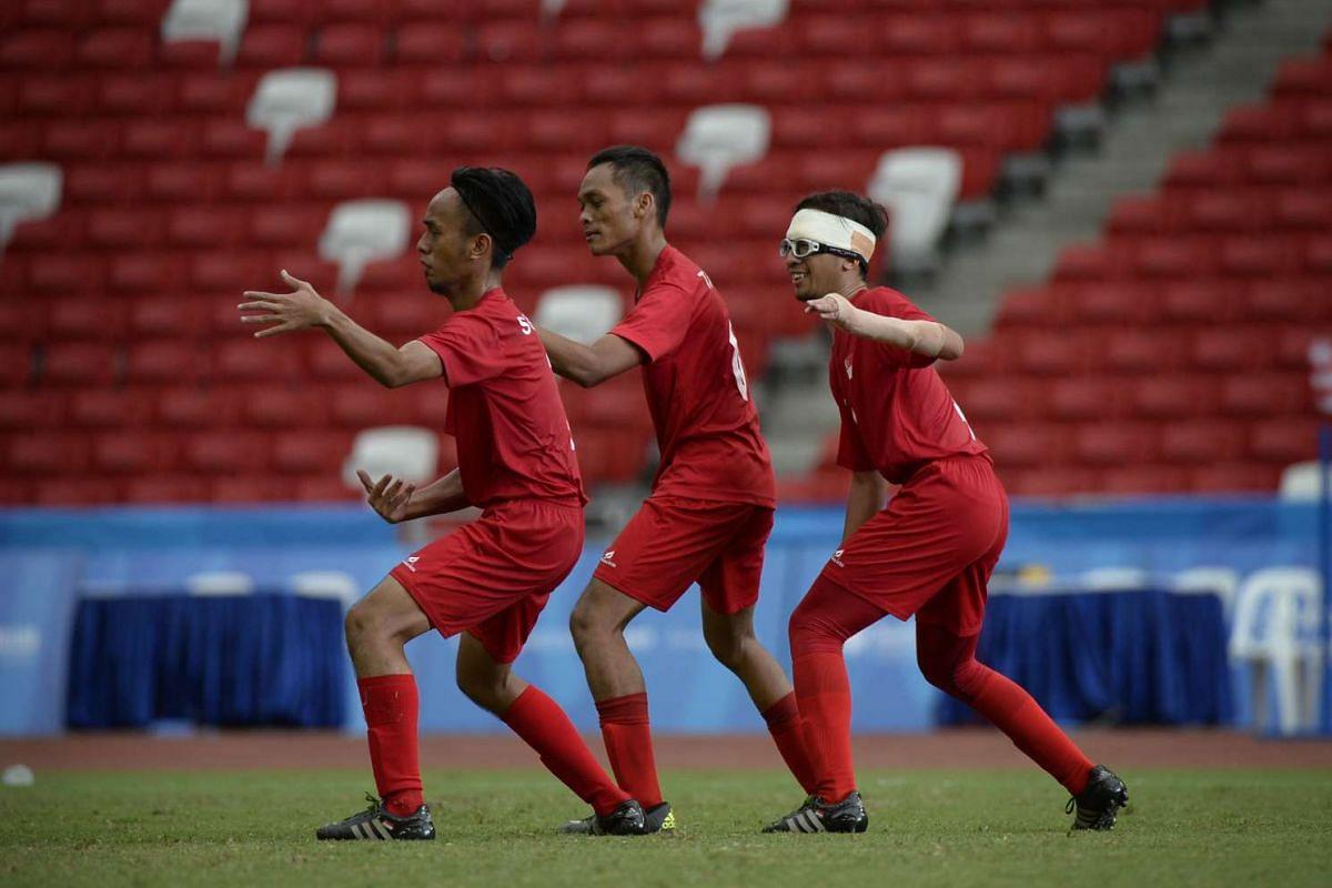 (From left) Cerebral palsy footballers Suhaimi Bin Sudar, Muhammad Taufiq Bin Baharin and Muhammad Shafiq Bin Arif.