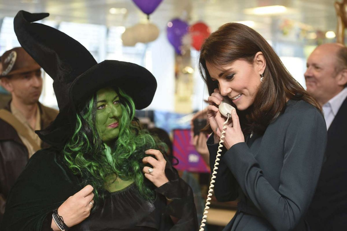 Catherine, Britain's Duchess of Cambridge, speaking on the telephone as she attends a charity event at city company ICAP, in central London, Britain on Dec 9, 2015.