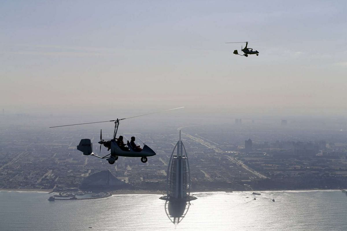 Gyrocopters fly over Dubai during the World Air Games 2015, United Arab Emirates on Dec 9, 2015.
