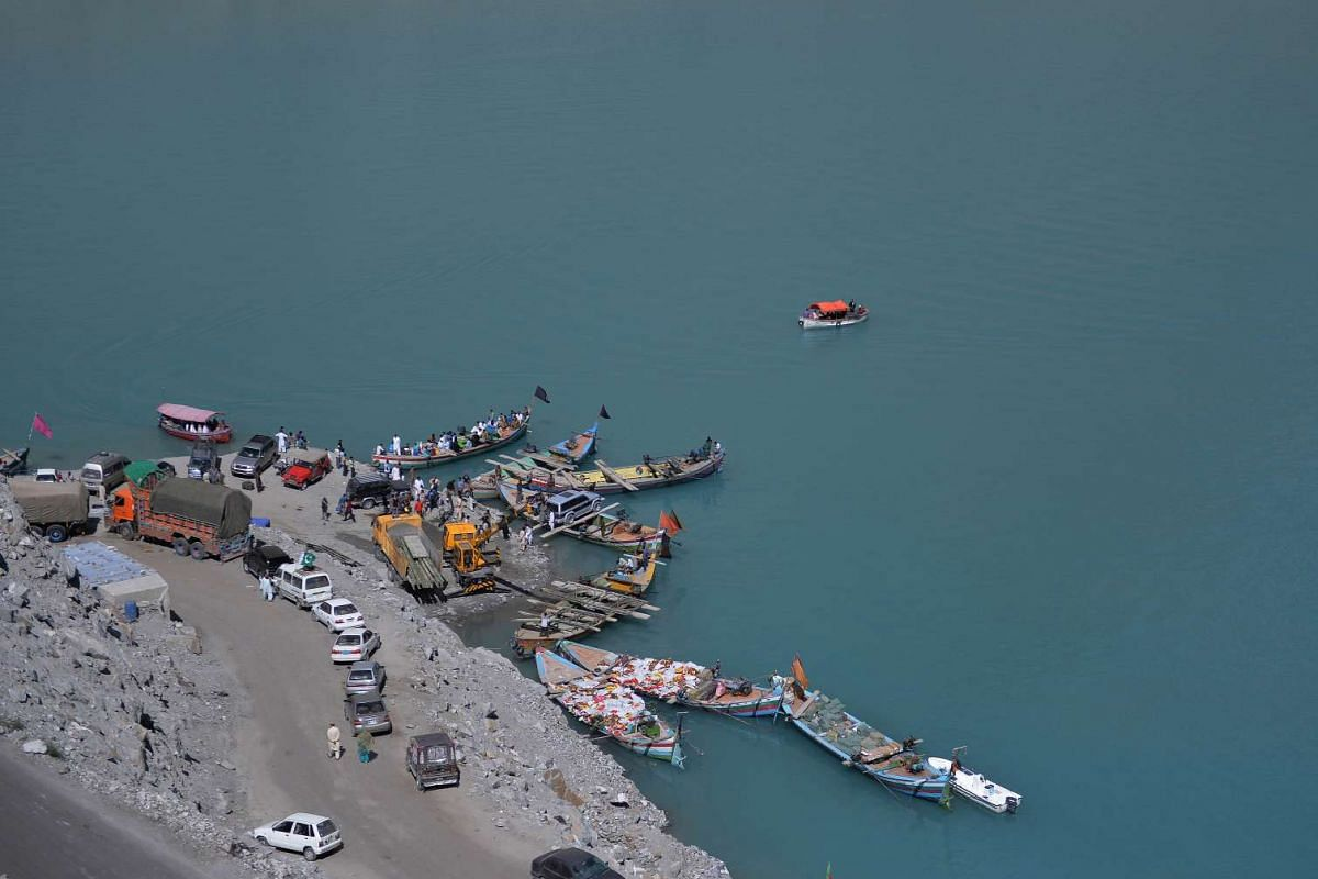 In this photo taken on Aug 3, 2015, Pakistani residents board boats used to cross Attabad Lake, which was formed following a landslide in January 2010 in Pakistan's Gojal Valley.