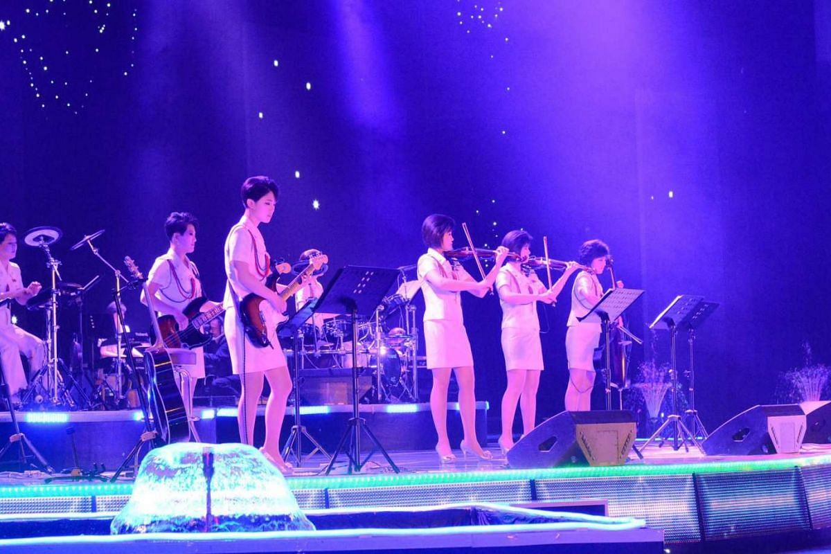 North Korean girl group Moranbong performing on stage.