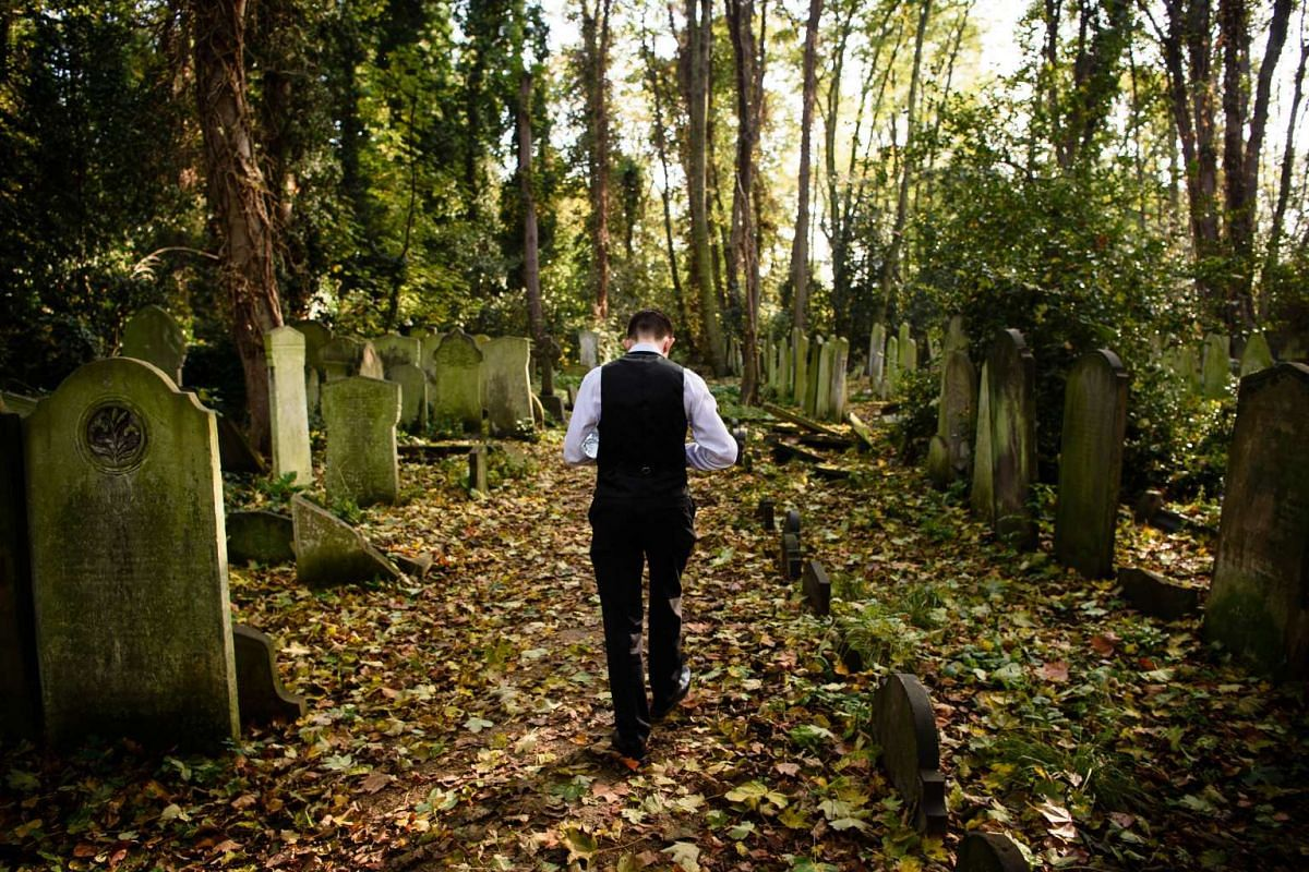 Tour guide Sheldon Goodman walking through Tower Hamlets cemetery in east London on Oct 31, 2015.