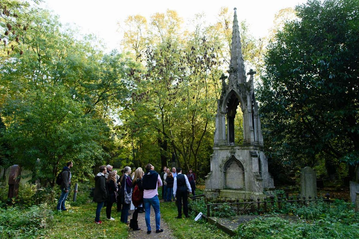 Tour guide Sheldon Goodman speaking to visitors at Tower Hamlets cemetery in east London on Oct 31, 2015.