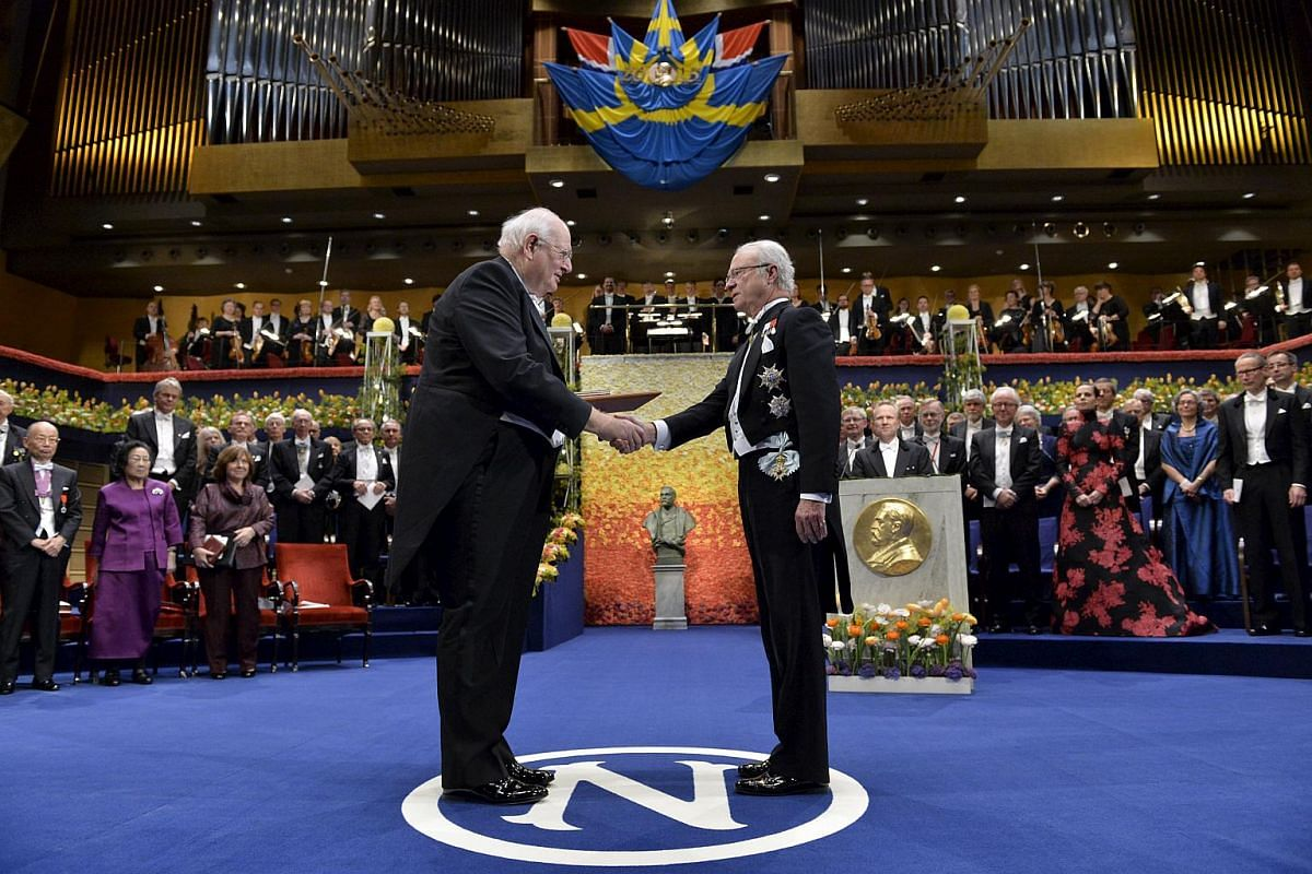 2015 Swedish Riksbank prize in economic sciences laureate Professor Angus Deaton (left) receives the award from King Carl Gustaf of Sweden.