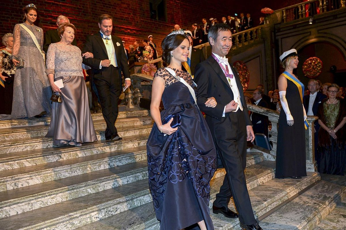 Princess Sofia and physics laureate Takaaki Kajita arrive in the Blue Hall for the 2015 Nobel prize award banquet in Stockholm City Hall.