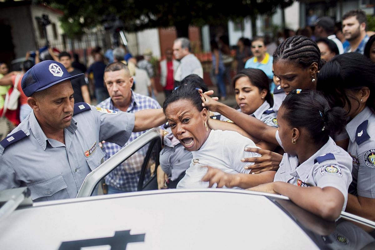 Cuban security personnel detaining a member of the Ladies in White dissident group during a protest on International Human Rights Day in Havana on Dec 10.