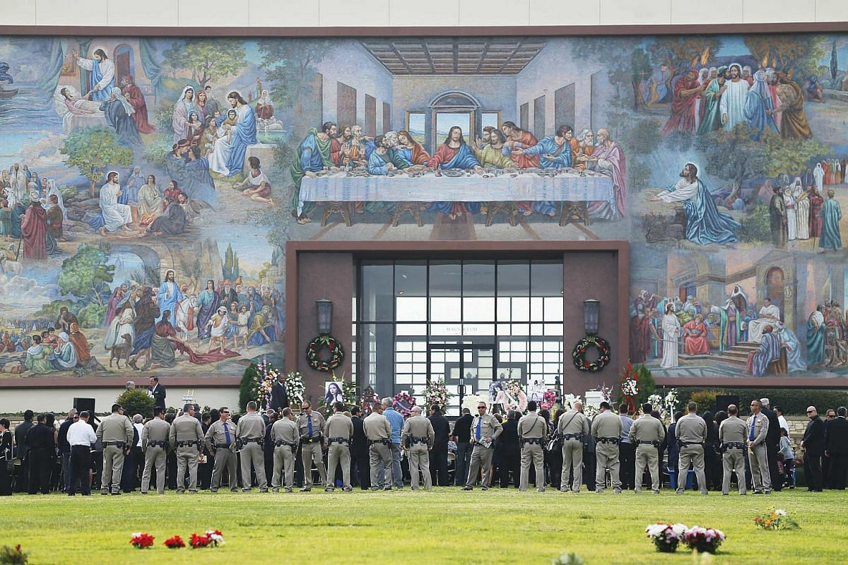 Mourners and California Highway Patrol officers paying their respects to San Bernardino shooting victim Yvette Velasco during a memorial service in Covina on Dec 10.