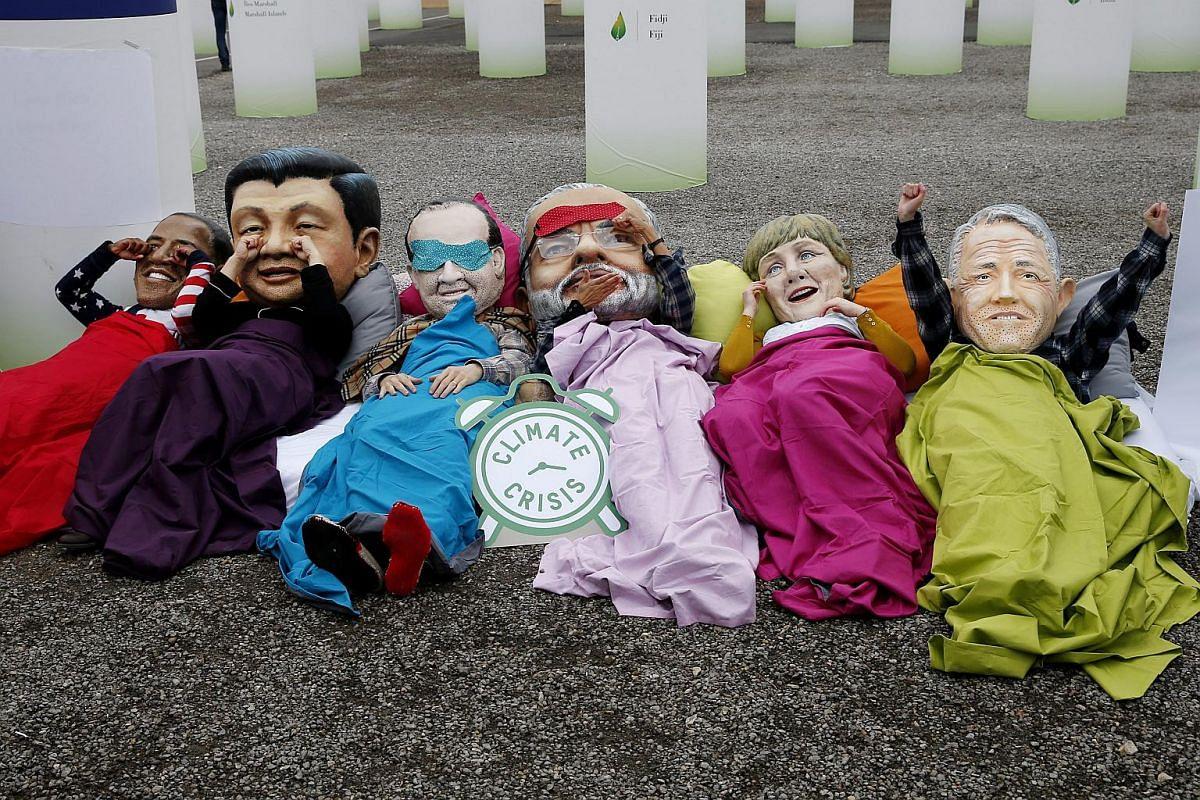 Demonstrators from NGO Oxfam dressed as world leaders (from left) US President Barack Obama, Chinese President Xi Jinping, French President Francois Hollande, Indian Prime Minister Narendra Modi, German Chancellor Angela Merkel and Australian Prime M
