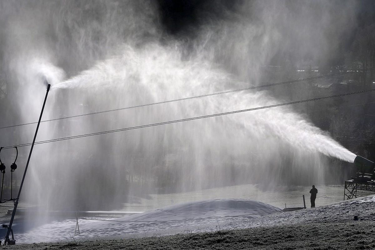 Artificial snow is sprayed onto a ski piste in Fischen, Germany, on Dec 10.