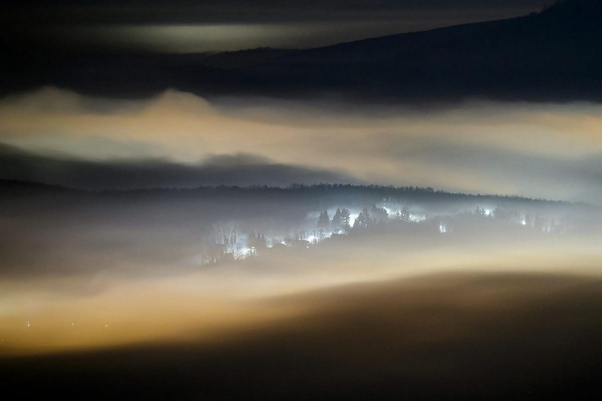 Fog floating above Salgotarjan, Hungary, after sunset on Dec 10.