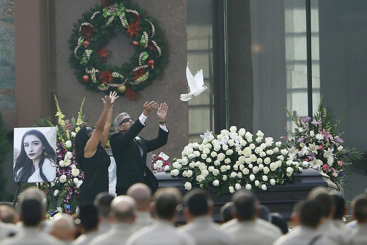 Parents of San Bernardino shooting victim Vyetter Velasco, Marie and Robert Velasco, releasing a white dove over her casket during a memorial service in Covina on Dec 10.