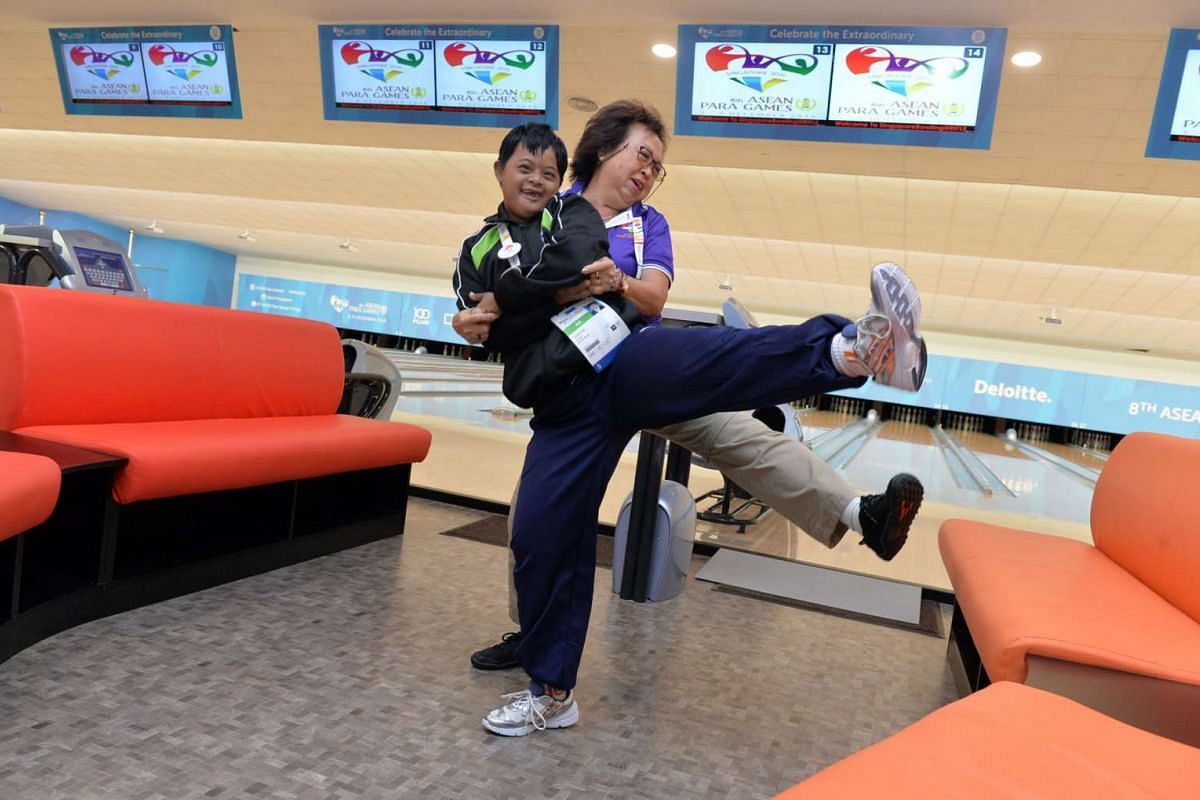 Volunteer Doreen Cady and Myanmar bowler Tazin Aye spontaneously break into a dance for a few minutes right after the bowling competition ends.