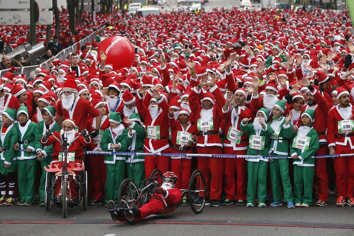 A total of 10,000 runners dressed as Santa Claus (Papa Noel in Spanish) ready for the start of the Santa Claus race outside Santiago Bernabeu stadium in Madrid, Spain, on Dec 12,  2015. They took part in a 5.5-km race to set a new Guinness World Reco