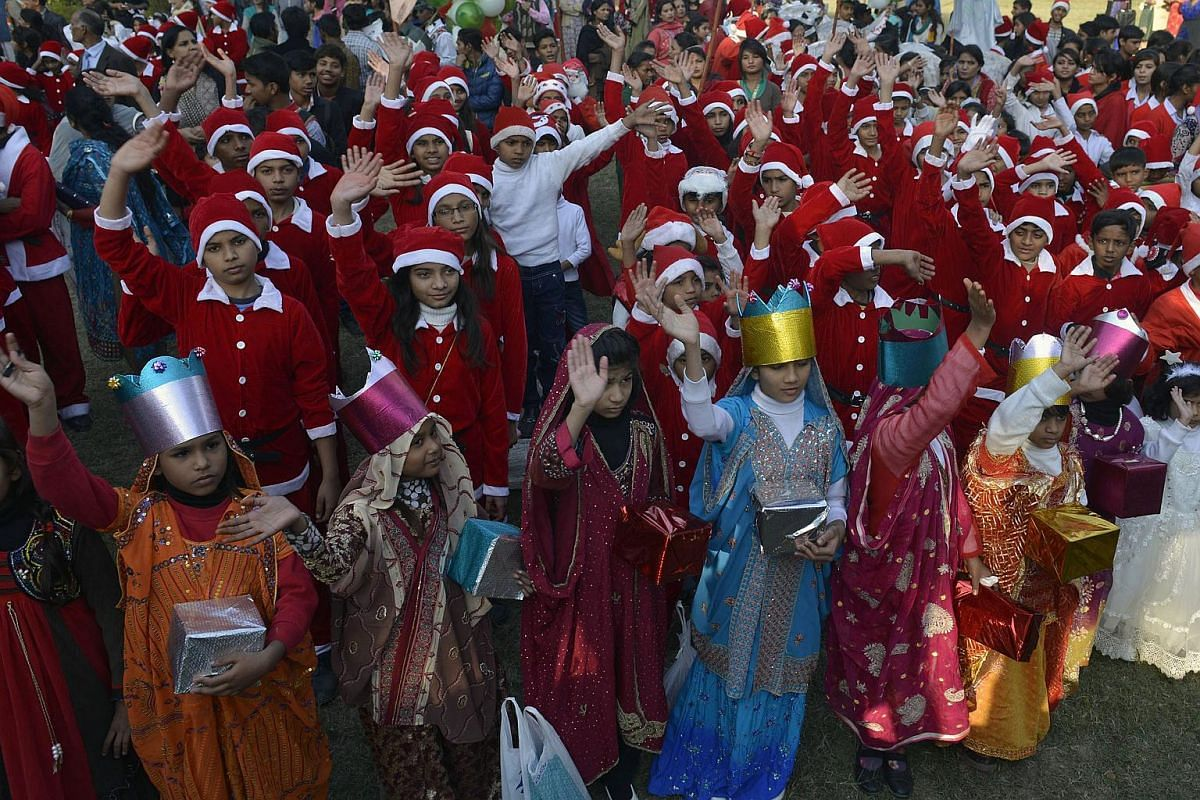 Pakistani Christian children dressed up as Christmas nativity characters and and Santa Claus take part in a peace rally at a church in Lahore on Dec 12, 2015.