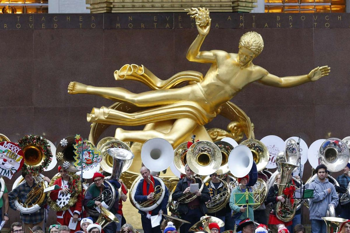 Hundreds of tenor and bass tuba players play Christmas songs in Rockefeller center in New York, New York, USA on Dec 13, 2015.