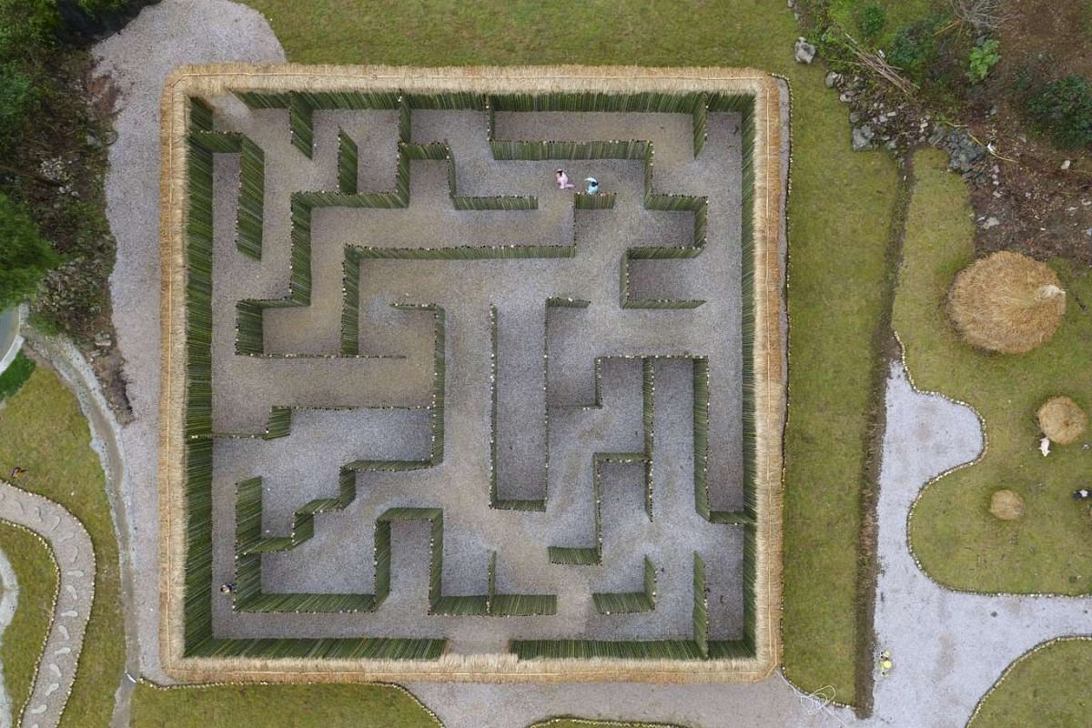An aerial view shows visitors walking in a maze, at a tourist resort in Zunyi, Guizhou province, China on Dec 13, 2015.