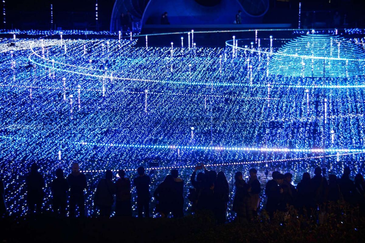 People looking at a display of illuminated Christmas lights at Tokyo Midtown's starlight garden in Tokyo, Japan, on Dec 5, 2015.