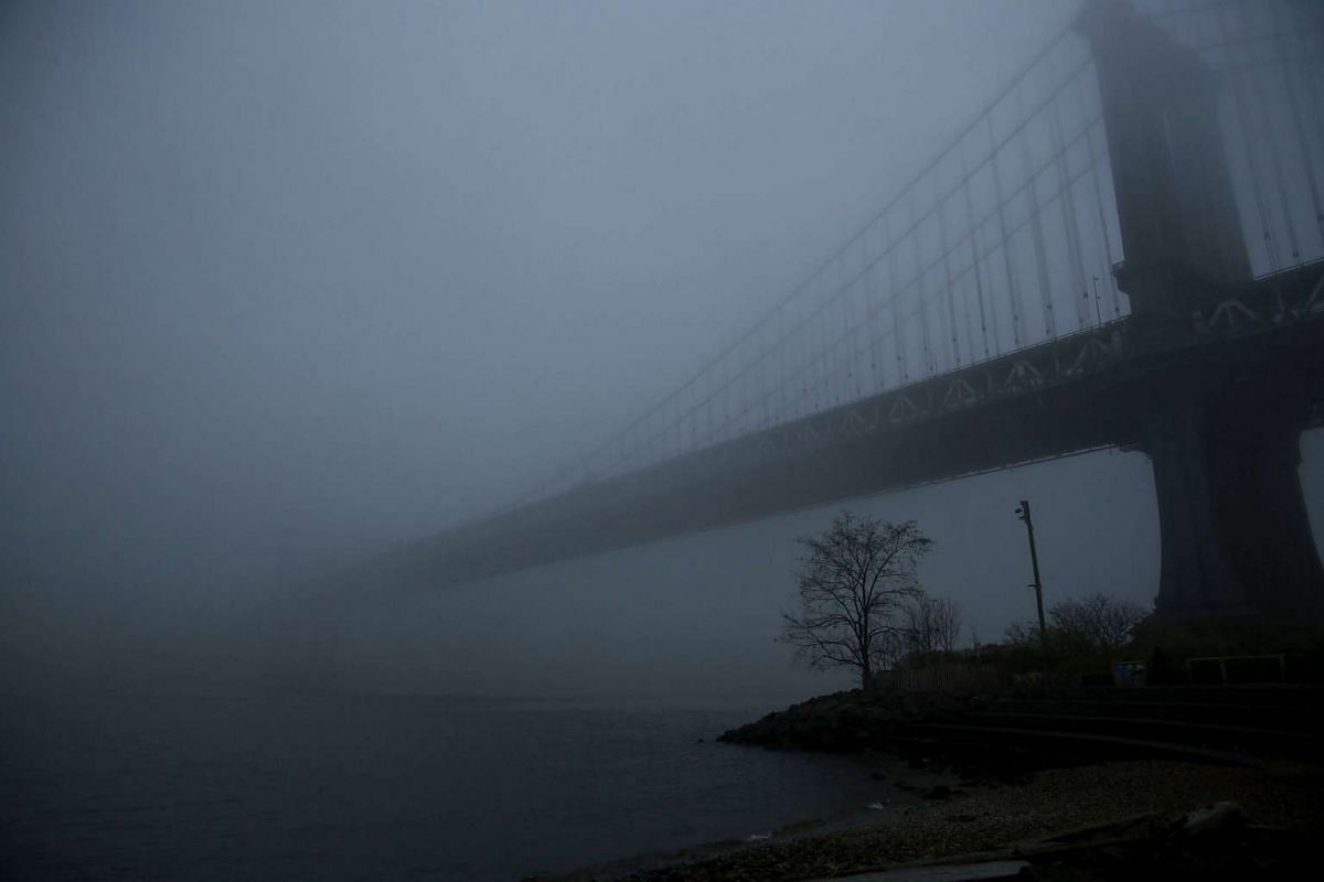 The Manhattan Bridge sits in morning fog on December 14, 2015 in New York City. Temperatures across much of the New York metropolitan area continued to be unseasonably warm with mid 60's being recorded in many areas over the weekend. PHOTO: GETTY IMA
