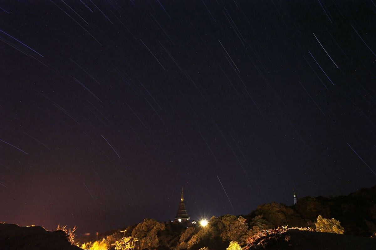 A 45-minute-long exposure photo shows stars trailing across the sky over a pagoda during a Geminid meteor shower phenomenon at Doi Inthanon mountain in Chiang Mai province, northern Thailand, early 15 December 2015. PHOTO: EPA
