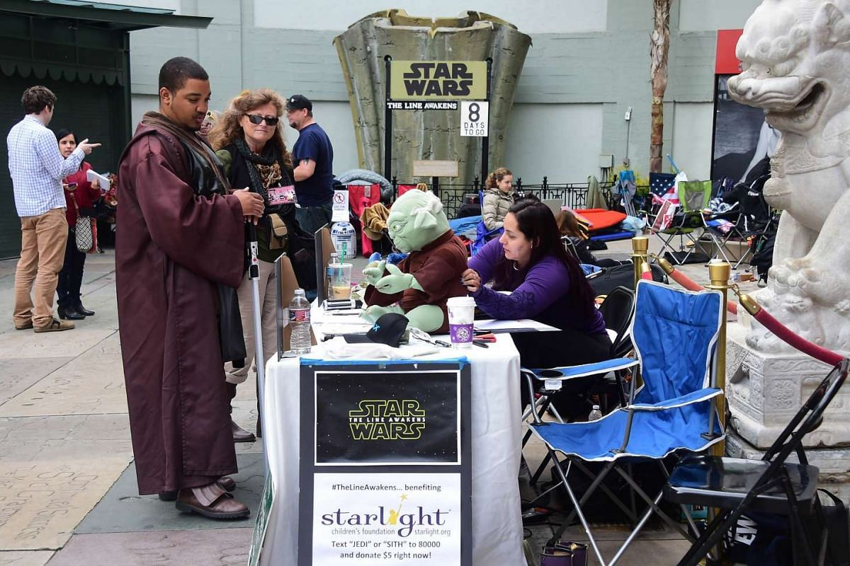 Star Wars fans in front of the TCL Theater in Hollywood, California, where more than 100 fans have camped out for three or four nights in anticipation of the new movie The Force Awakens, which opens on Dec 17.