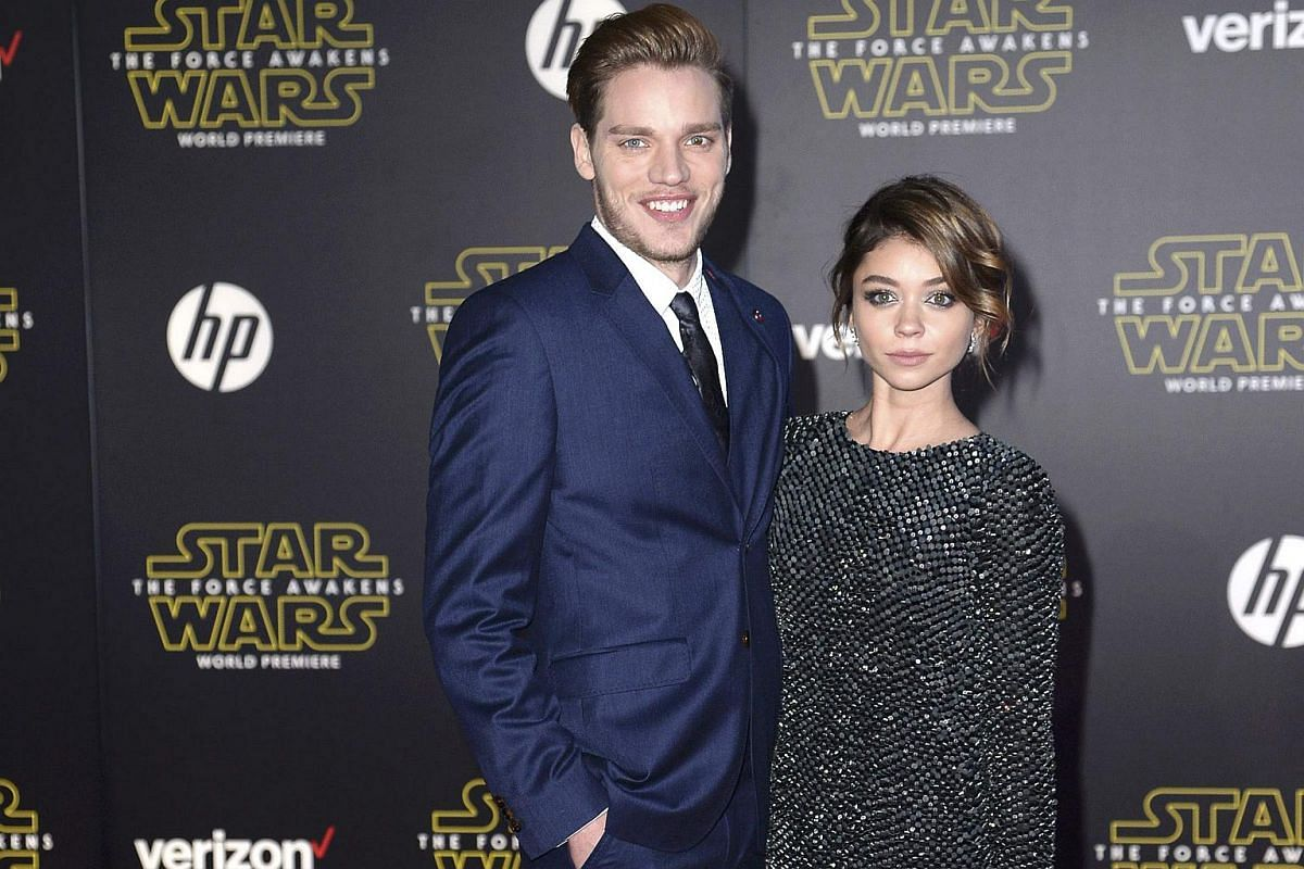 Actors Dominic Sherwood (left) and Sarah Hyland arriving at the premiere of Star Wars: The Force Awakens.