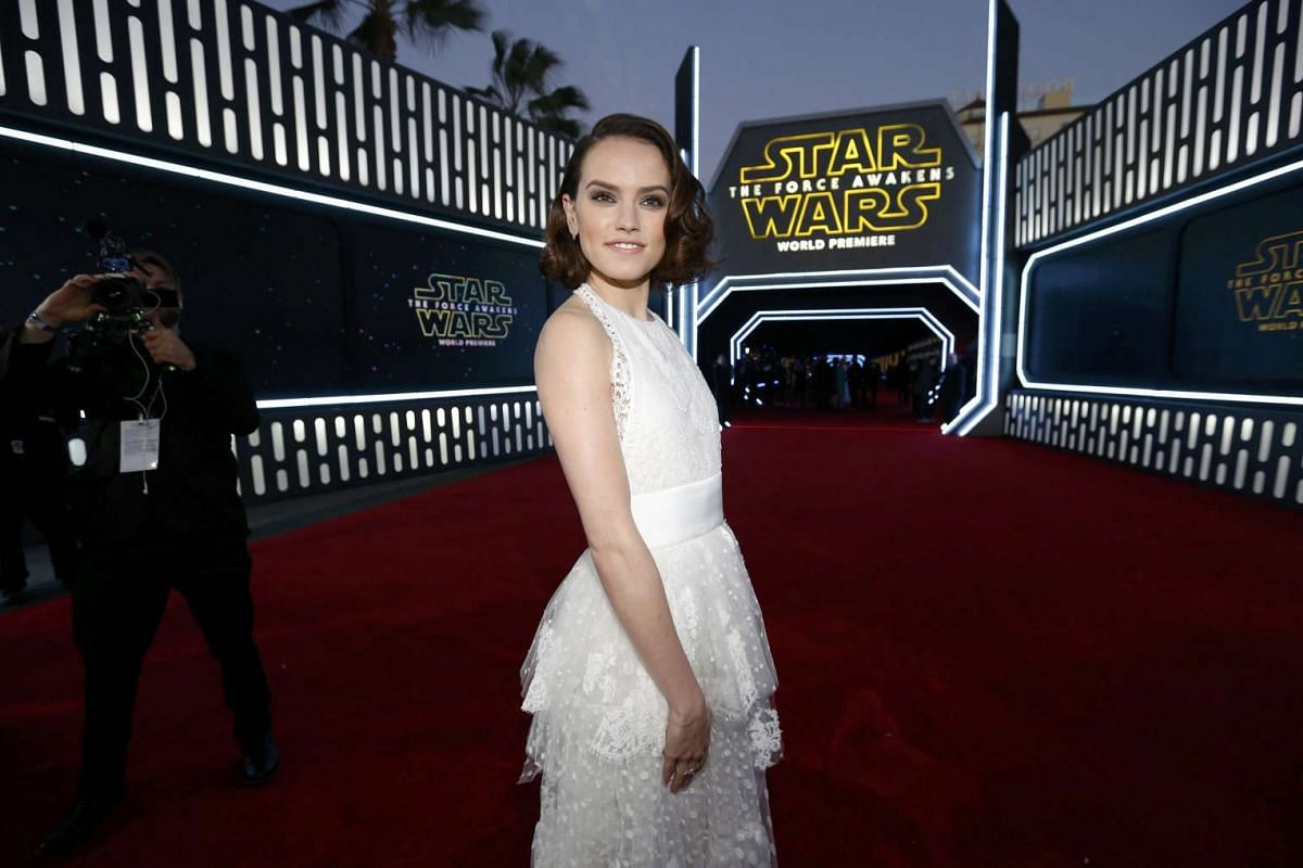 Actress Daisy Ridley arriving at the premiere of Star Wars: The Force Awakens.