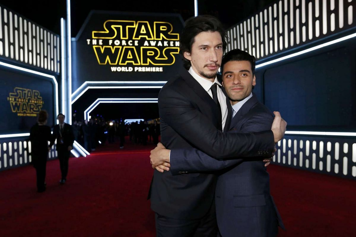 Actors Adam Driver (left) and Oscar Isaac embracing as they arrive at the premiere of Star Wars: The Force Awakens.
