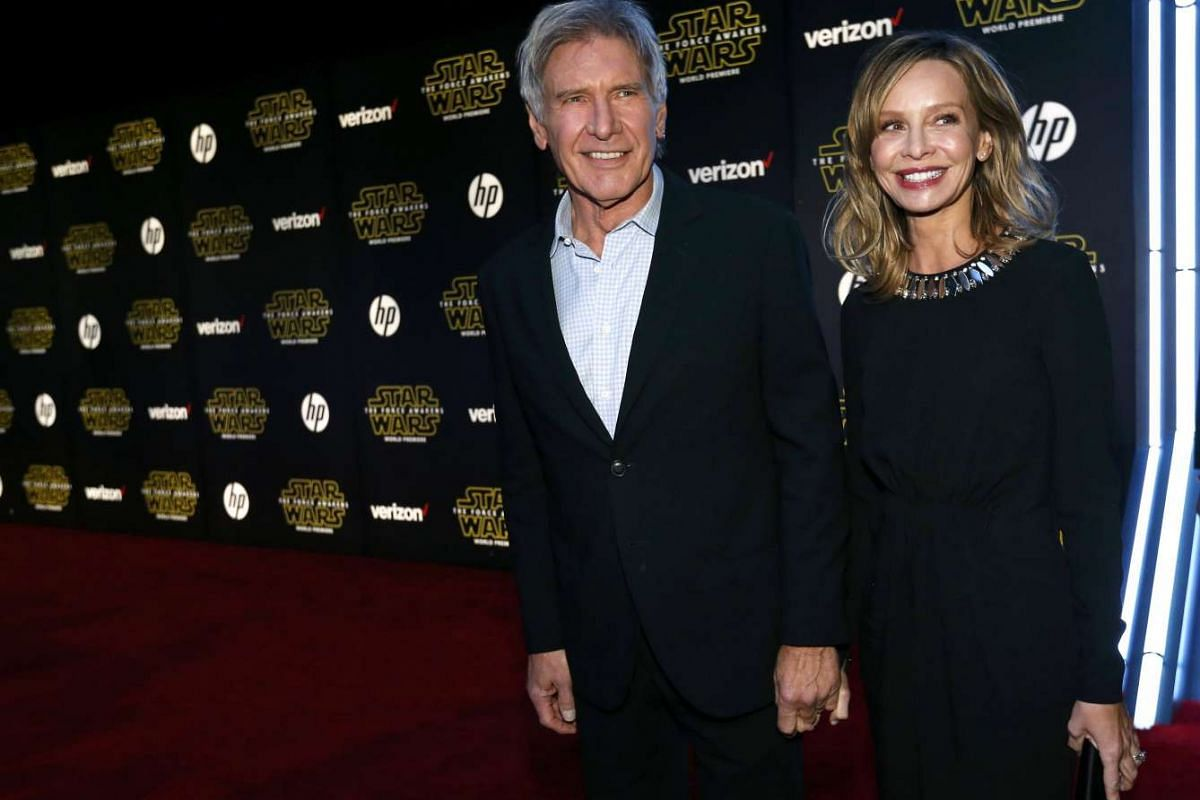 Actor Harrison Ford (left) and wife, actress Calista Flockhart, arriving at the premiere of Star Wars: The Force Awakens.