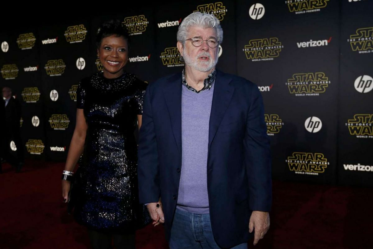 Star Wars creator George Lucas and wife, Mellody Hobson, arriving at the premiere of Star Wars: The Force Awakens.