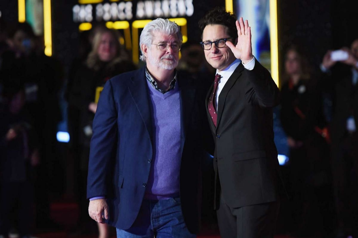 Film-maker George Lucas (left) and writer-director J.J. Abrams arriving at the premiere of Star Wars: The Force Awakens.