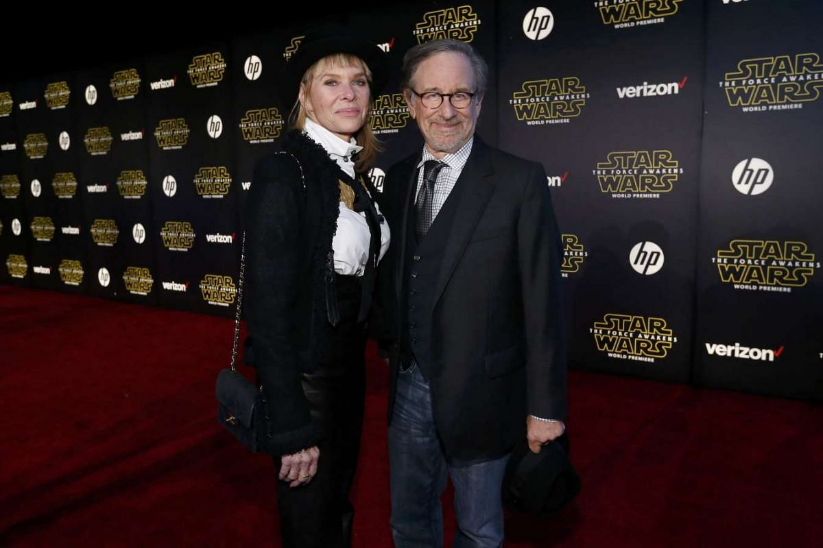 Director Steven Spielberg (right) and wife, actress Kate Capshaw, arriving at the premiere of Star Wars: The Force Awakens.