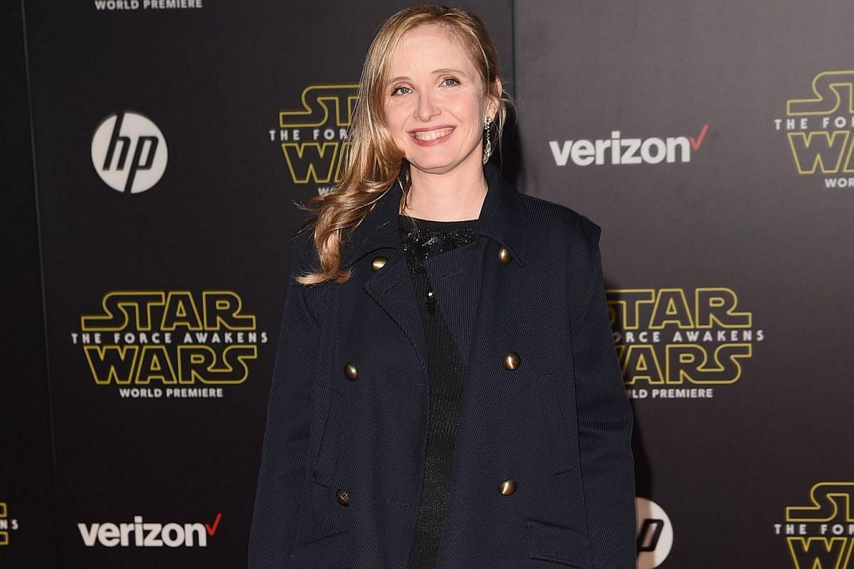 Actress Julie Delpy arriving at the premiere of Star Wars: The Force Awakens