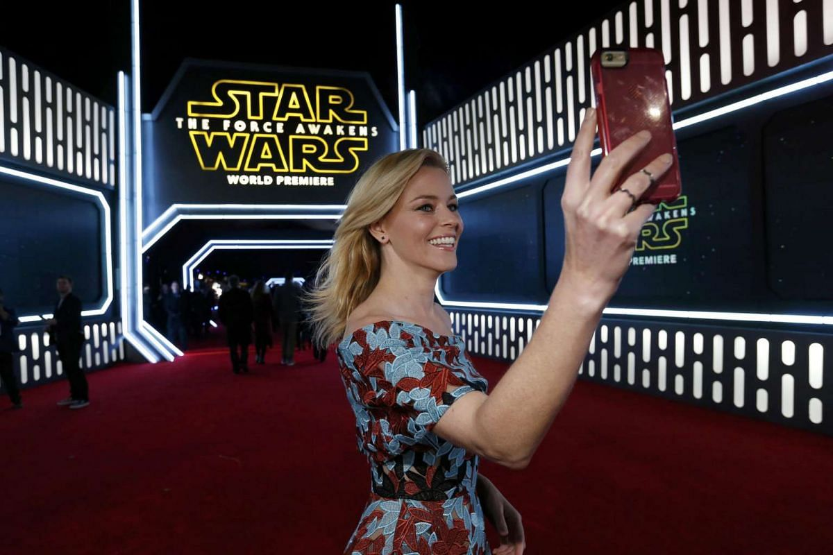Actress Elizabeth Banks taking a selfie as she arrives at the premiere of Star Wars: The Force Awakens.