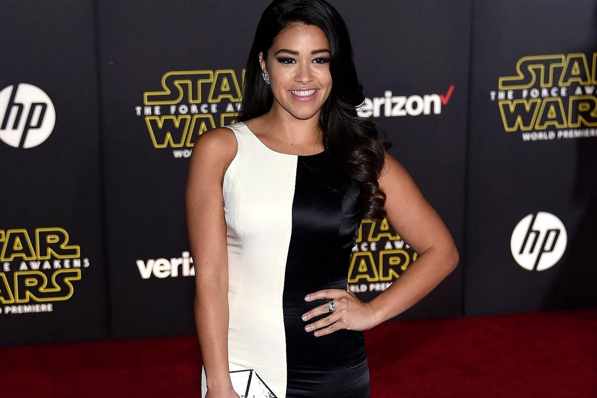 Actress Gina Rodriguez arriving at the premiere of Star Wars: The Force Awakens.